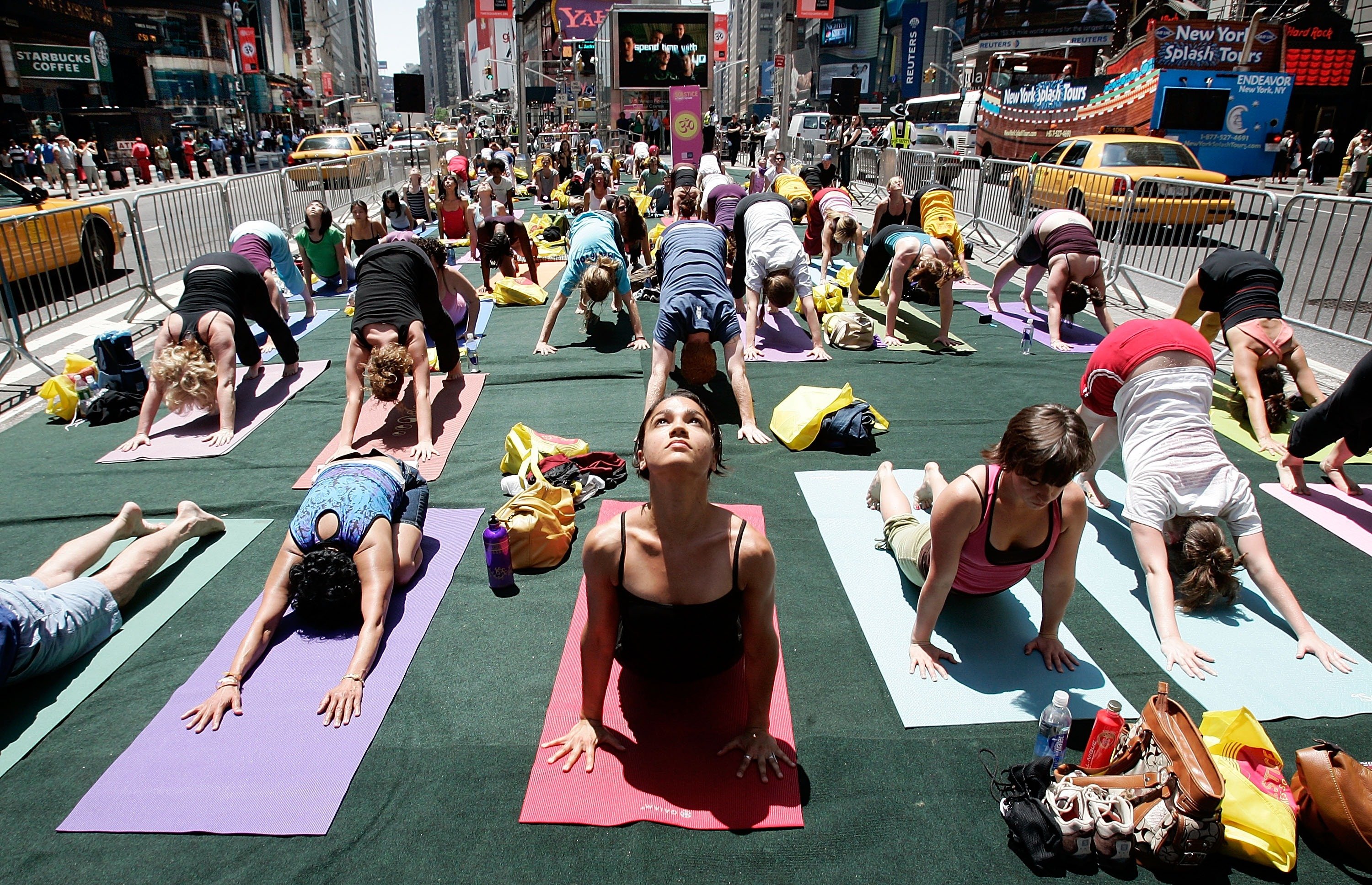 Yoga Practitioners Greet Summer Solstice In Times Square